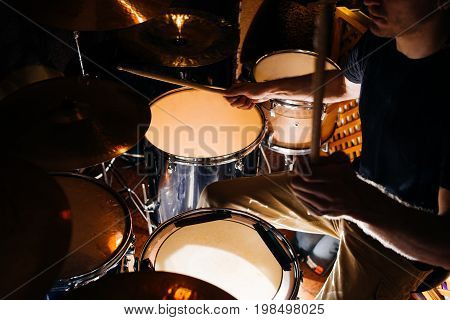 Drum kit during concert closeup. Atmospheric live show, creative hobby for male, music background