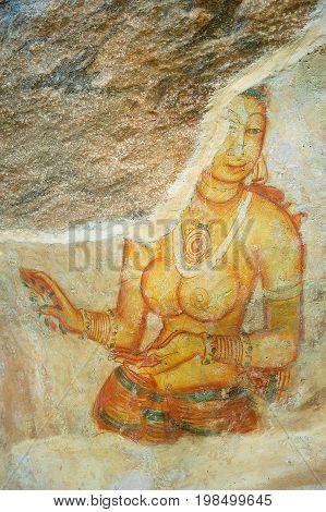 SIGIRIYA, SRI LANKA - MAY 20 ,2011: Exterior of the ancient damaged painting at Sigiriya rock in Sigiriya, Sri Lanka. Sigiriya is a UNESCO World Heritage Site.