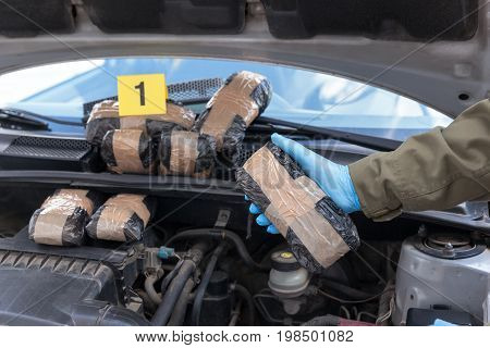 Drug smuggling in a car engine compartment