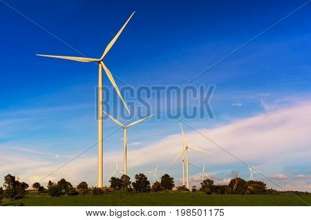 Clean Energy; Wind Turbine Generates Electricity In Agricultural Fields, Alternative Energy From Nat