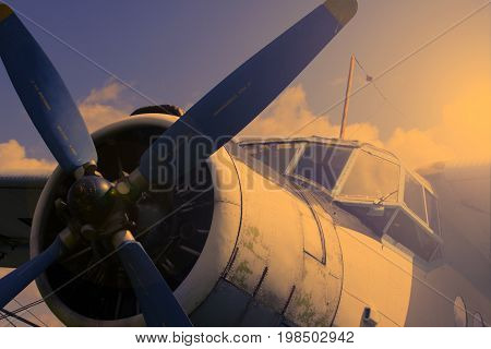 old rotorcraft plane at sunset Against the blue sky