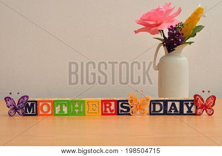 Mothers day with a colorful bouquet of flowers and silk butterflies