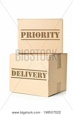 Two corrugated cardboard carton parcels with Priority Delivery imprint