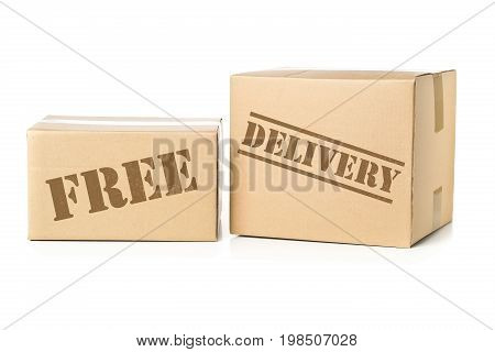 Two corrugated cardboard carton parcels with Free Delivery imprint
