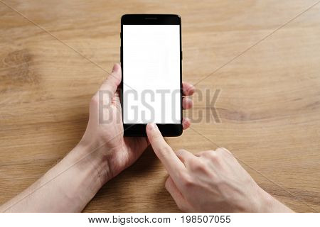 young man hands holding smartphone with blank white screen, shallow focus