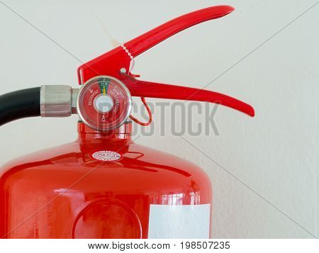close up Fully Charged Meter on red Fire Extinguisher.