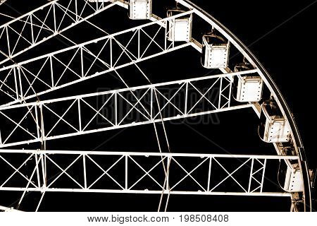 Low angle view of ferris wheel against dark night sky