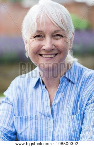 Outdoor Head And Shoulders Portrait Of Mature Woman