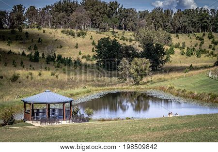 Wooden gazebo standing by pond at Ocean View Winery Queensland Australia