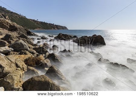 Rancho Palos Verdes rocky coast view with motion blur waves in Los Angeles County, California.