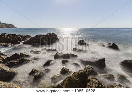 Rancho Palos Verdes rocky coast view with motion blur waves near Los Angeles in Southern California.