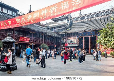 Shanghai, China - Nov 6, 2016: In the 600-year-old Old City God Temple. Crowds of patrons gather around the main courtyard to offer their prayers.