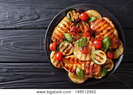 Chicken Fillet Grilled With Vegetables In A Sweet-hot Sauce Close-up. Horizontal Top View