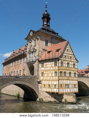BAMBERG, GERMANY - MAY 26, 2017: Famous city hall of Bamberg located in the middle of the Regnitz river on May 26, 2017 in Bavaria, Germany