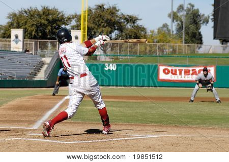 MESA, AZ - NOV 20: Quintin Berry of the Mesa Solar Sox swings in the Arizona Fall League baseball game between the Solar Sox and the Scottsdale Scorpions on November 20, 2008 in Mesa, Arizona.