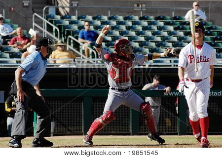 MESA, AZ - NOV 20: Jeremy Slayden of the Mesa Solar Sox strikes out with Mark Wagner of the Scottsdale Scorpions behind the plate in the Arizona Fall League game on November 20, 2008 in Mesa, Arizona.