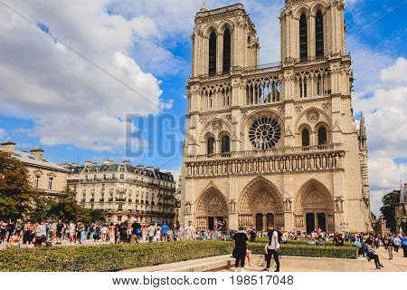 Tourists Queuing To Enter The Notre Dame Cathedral In Paris, France