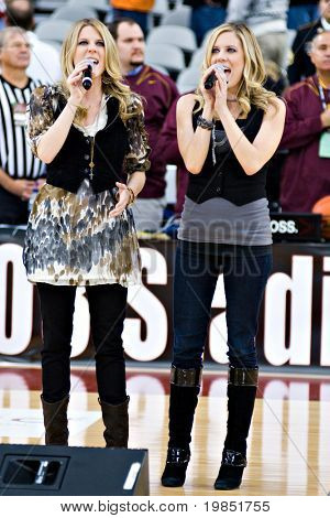 GLENDALE, AZ - DECEMBER 20: Kate and Kacey Coppola sing the National Anthem before the basketball game between the Minnesota and Louisville on December 20, 2008 in Glendale, Arizona