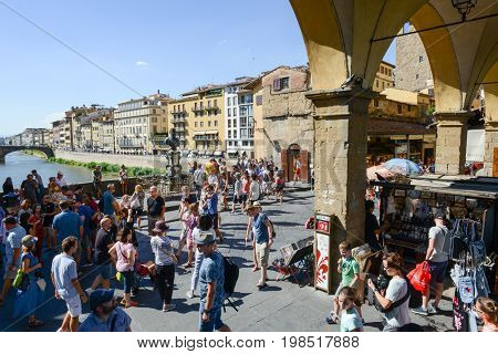 People Walking Over The Bridge Of Ponte Vecchio In Florence