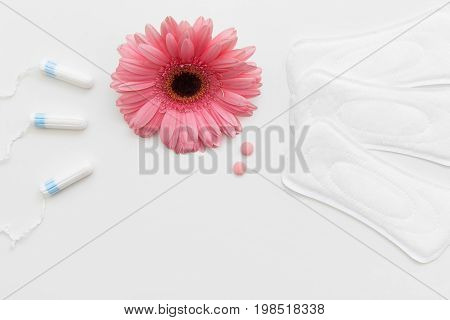 Tampon and hygiene pad on white background, female healthcare. Birth control pill, contraception and regular cycle., woman stuff, menstruation concept
