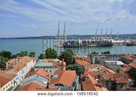 Koper, Slovenia - July 10th 2017. An aerial view of the port area in the historic Slovenian coastal town of Koper. Taken from the top of Koper Cathedral (Cathedral of the Assumption of the Blessed Virgin or Stolna cerkev Marijinega Vnebovzetja.