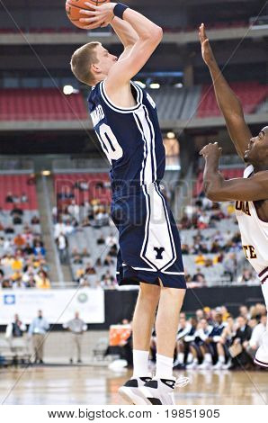 GLENDALE, AZ - DECEMBER 20: Brigham Young University forward Lee Cummard #30 puts up a jump shot during the basketball game against Arizona State on December 20, 2008 in Glendale, Arizona.