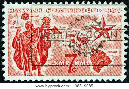 USA - CIRCA 1959: A stamp printed in USA issued for the Hawaii Statehood shows Alii Warrior, Map of Hawaii and Star of Statehood, circa 1959.