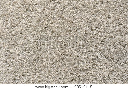 Beige Towel Texture Background. Texture of a beige towel or carpet