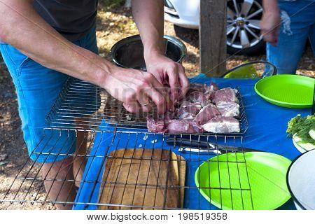 Man Cooking Marinated Shashlik