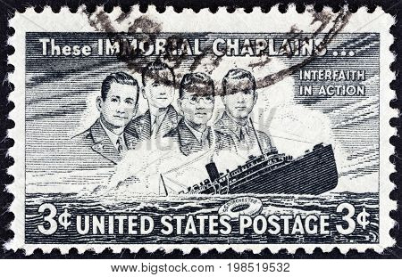 USA - CIRCA 1948: A stamp printed in USA issued for the 5th death anniversary of George Fox, Clark Poling, John Washington and Alexander Goode shows Four Chaplains and Liner Dorchester, circa 1948.