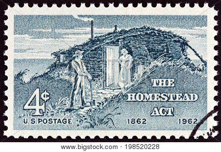 USA - CIRCA 1962: A stamp printed in USA issued for the centenary of Homestead Act shows Settlers, circa 1962.