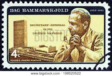 USA - CIRCA 1962: A stamp printed in USA shows Dag Hammarskjold and U.N. Headquarters, circa 1962.