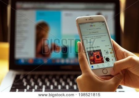 Singapore. July, 2017:a Woman Is Typing On Ebay Search Engine From Phone And Laptop; Ebay Websites T