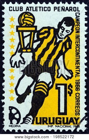 URUGUAY - CIRCA 1968: A stamp printed in Uruguay issued for Penarol Club's Victory in Intercontinental Football Championships shows footballer, circa 1968.