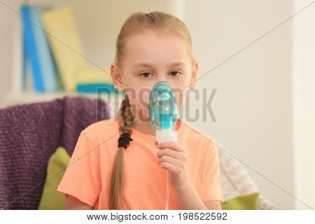 Girl using asthma machine at home