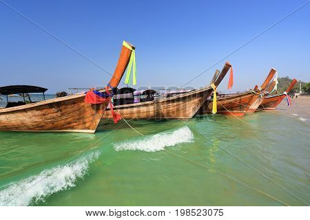 Longtail boats at  Ao Nang beach,  Krabi , Thailand .