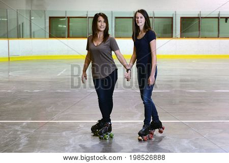 mother daughter quad roller skating focus on mother