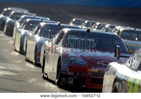 AVONDALE, AZ - APRIL 18: Dale Earnhardt Jr. #14 in a line of cars at the start of the NASCAR Sprint Cup race at the Phoenix International Raceway on April 18, 2009 in Avondale, AZ.