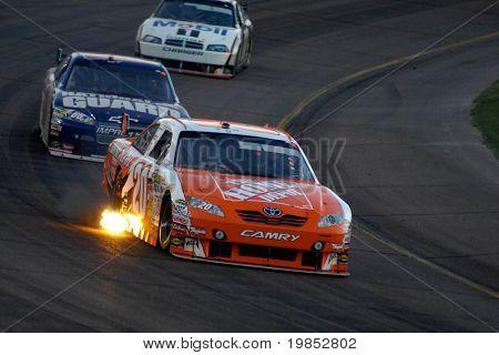 AVONDALE, AZ - APRIL 18: Joey Logano #20 leads Dale Earnhardt Jr. #88 in the NASCAR Sprint Cup race at the Phoenix International Raceway on April 18, 2009 in Avondale, AZ.
