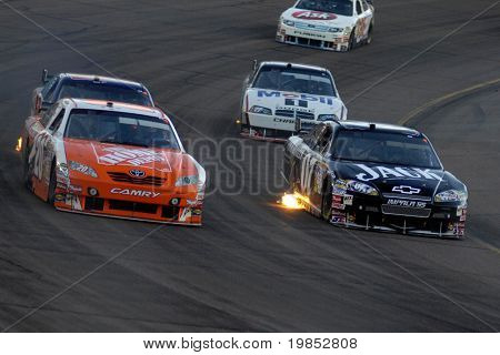 AVONDALE, AZ - APRIL 18: Joey Logano #20 and Casey Mears #07 compete in the NASCAR Sprint Cup race at the Phoenix International Raceway on April 18, 2009 in Avondale, AZ.