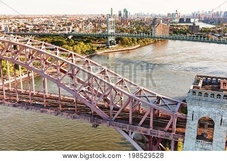 Aerial view of the Hell Gate Bridge over the East River in New York City