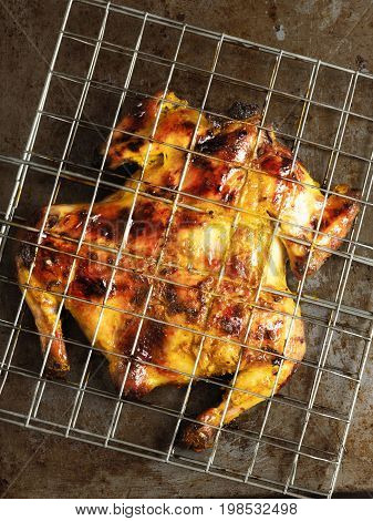 close up of rustic barbecued whole chicken