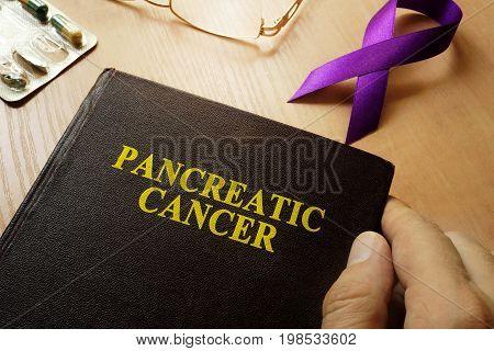 Symbol of pancreatic cancer. Purple awareness ribbon.