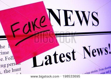 Propaganda concept. Screen of monitor with Fake news.