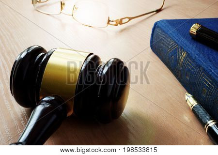Law concept. Gavel and book on a court table.