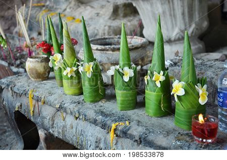 Sacrificial Offering Made From Banana Leaf And Flower Praying To Buddha And God At Vat Phou Or Wat P