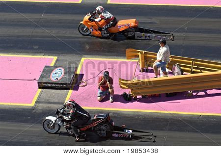 CHANDLER, AZ - OCTOBER 2: Motorcycles compete in the NHRA Pacific Division drag racing championship on October 2, 2009 in Chandler, Arizona.
