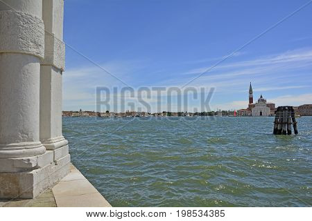 The island of Giudecca in the Dorsoduro quarter of Venice viewed from the opposite side of the Giudecca canal at the Punta Della Dogana. The 16th century benedictine church Chiesa di San Georgio Maggiore can be seen on the right