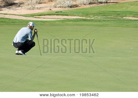 SCOTTSDALE, AZ - OCTOBER 21: George McNeill prepares to putt in the Frys.com Open PGA golf tournament on October 21, 2009 in Scottsdale, Arizona.