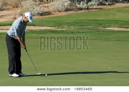SCOTTSDALE, AZ - OCTOBER 21: George McNeill prepares putts in the Frys.com Open PGA golf tournament on October 21, 2009 in Scottsdale, Arizona.